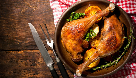 Roasted goose legs with oranges